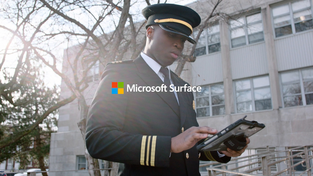 A government worker using touch on his Surface Pro device on the move.